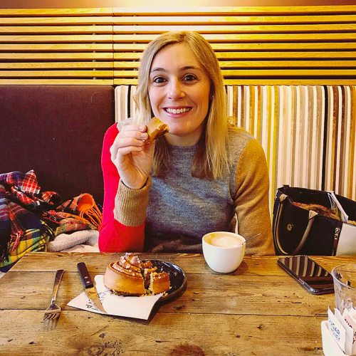 Nikki from The Smiling Food Journal eating a pastry