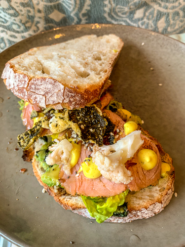 Mr Baker Goes to Asia Sandiwch from Baker and Moore. Avocado nori mash with flamed salmon, pickled cauliflower and curry mayo