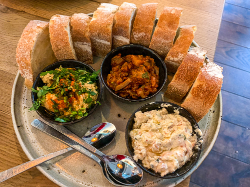 Spelt bread, with a selection of chickpea, yoghurt dip as well as eggplant tomato stew.