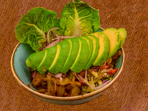Salad leaves garnished with sliced avocado, black beans were layered with spring onion rice, shredded beef braised in chipotle, grated cheese, and pico de gallo.