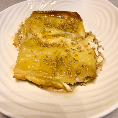 Baked filo pastry filled with spinach and feta cheese