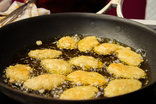 mizithra cheese in a frying pan of oil